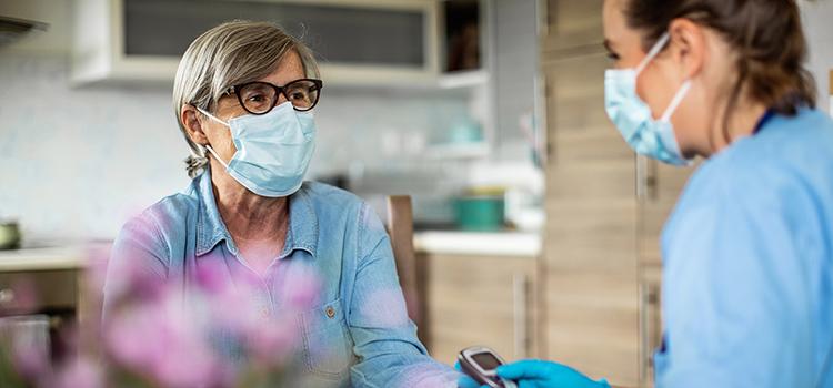 Nurse monitoring a patient's health